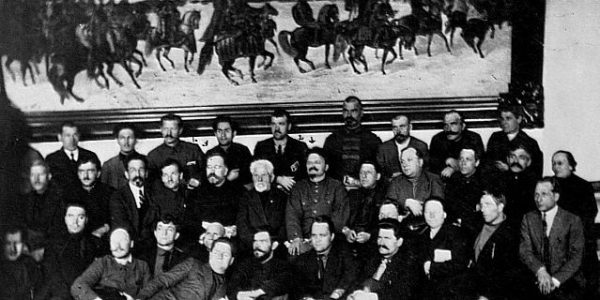 12 Jun 1923, Moscow, USSR --- Leon Trotsky gathers with the members of the 12th Congress of Russian Communists in the Kremlin. M. Kamenev also appears, substituting for Lenin. --- Image by © CORBIS